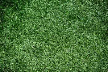 Artificial grass is unsuitable under a swing set
