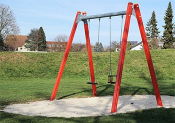 Sand under a swing set has little impact resistance